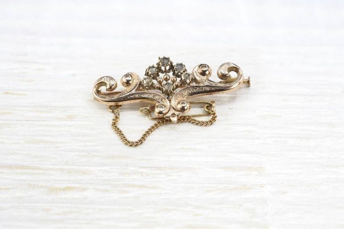 19th century brooch in gold set with pink diamonds.