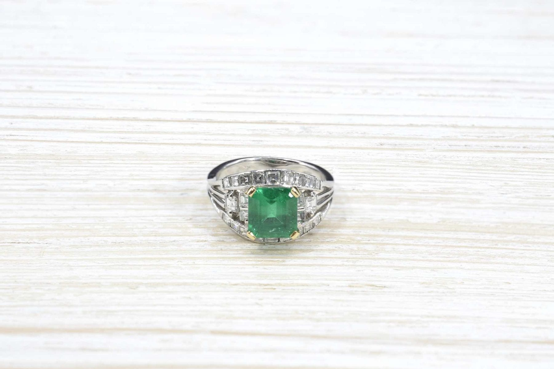 emerald ring set with diamonds